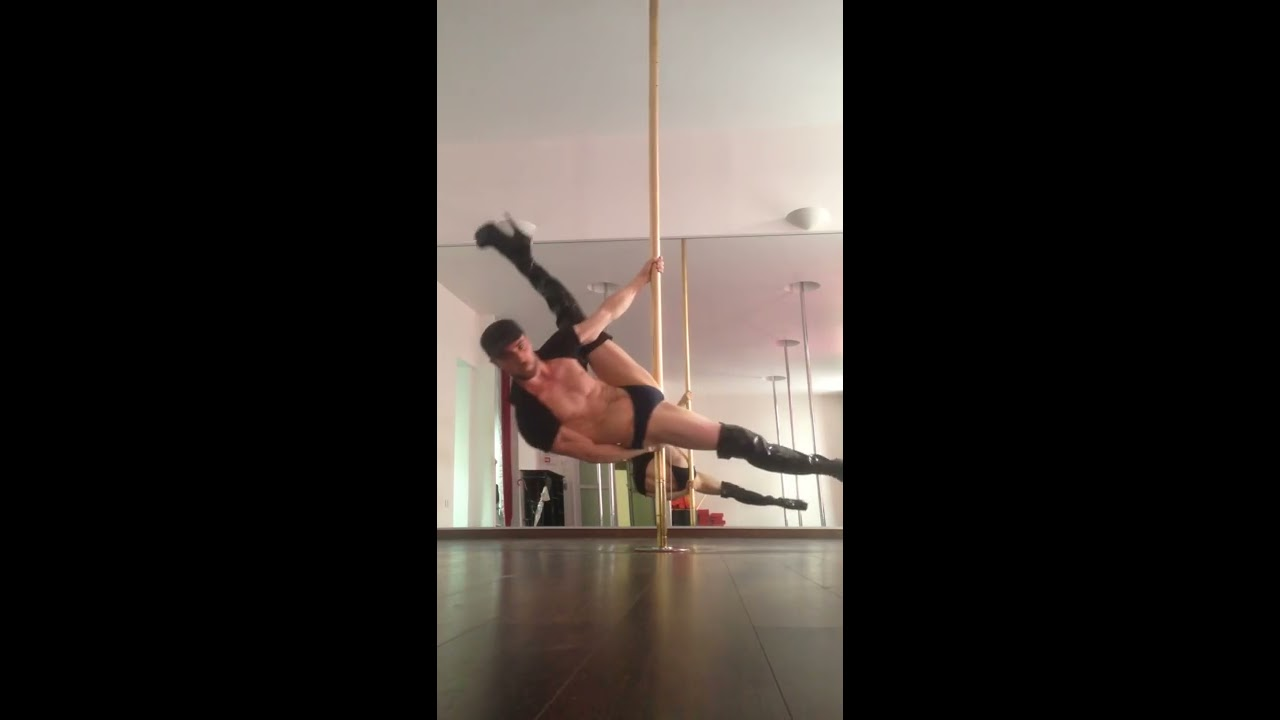 Guy pole dancing in high heels