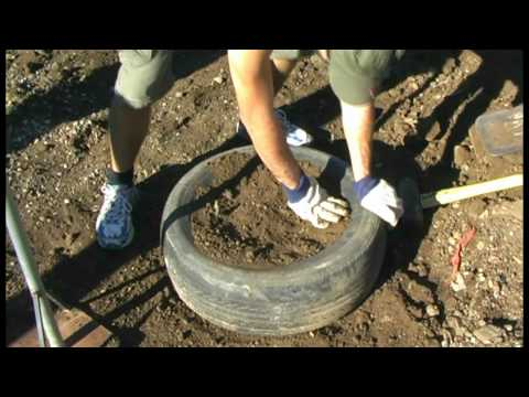 Tyres #2: Hand packing, jumping and kicking - CERES Earthships Australia