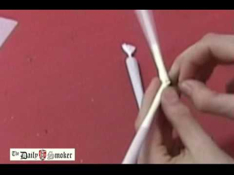 Daily Smoker - roll a joint - Holy Cross