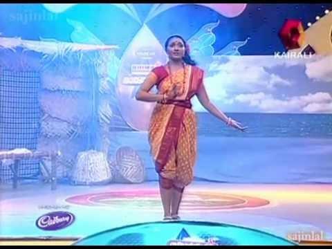 "Poornasree in Tharothsavam - ""Kozhi koovum neram..""  Team Sougandhikam's Favorite Liricsist round"
