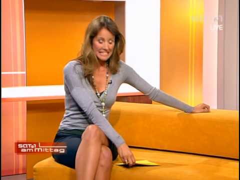 Mareile Höppner in shorts and crossed legs