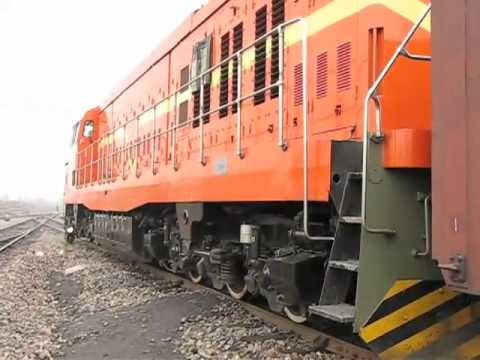 The shunting engine DF4DD 0096 haul the Freight train at PingDingShan with great horn