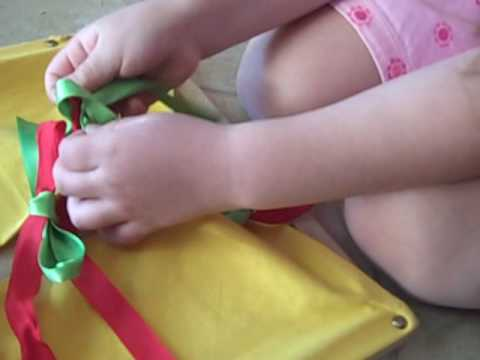 Montessori Tying Frame Demonstration by 4 year old, Calista