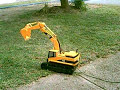 CAT Backhoe in action digging sewer Funny video of Mini Cat