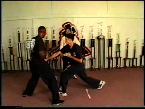 William Cheung teaches Wing Chun for Point-Technique number 7 A Fake and a Low Puch