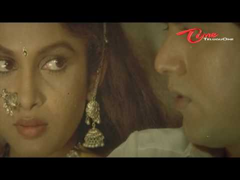 Heroine Ramya Krishna'a hot romancing scene from a telugu movie
