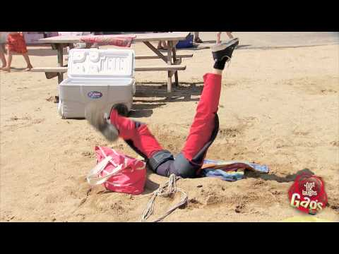 Skydiver Crashes On Beach