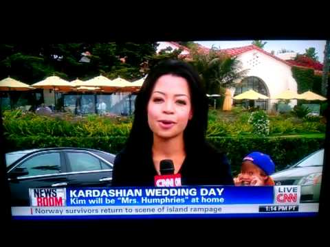 Little kid trolls CNN camera woman talking about Kim Kardashian-s wedding