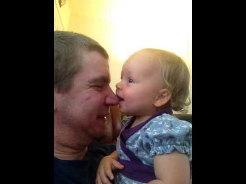 Alice licking her daddy's nose