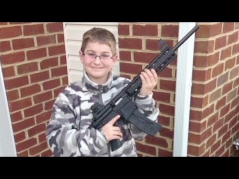 Cops called over photo of boy with rifle  (cnn)