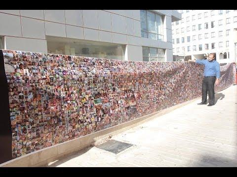 شاهد بالفيديو: أكبر لوحة فوتوغرافية تضم صورا لخمسين ألف قتيل سوري