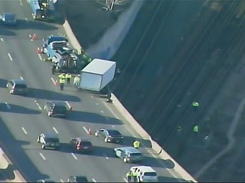 Raw: Truck Hangs Off Boston Highway Bridge