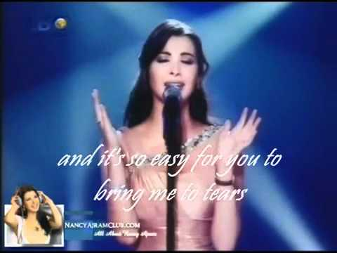 Nancy Ajram Mestaniyak Live in Ebtada el Meshwar part 1 EXCLUSIVE english LYRICS2.flv