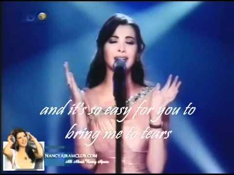 Nancy Ajram Mestaniyak Live in Ebtada el Meshwar part 1 EXCLUSIVE english LYRICS2.flv