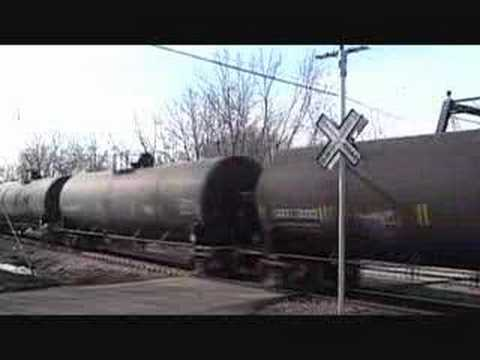 CN Mixed Freight Train Passing Rare Grade Crossing Signal