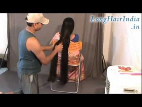 Elegantly Playing with Knee Length Silky Hair