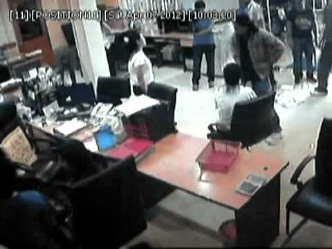 CCTV shows disgruntled mob attacks used car dealer