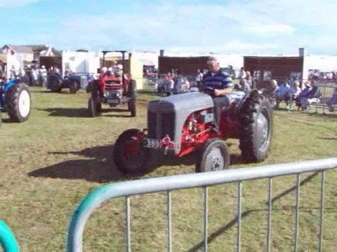Classic tractors driving around arena - West Show 2008