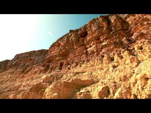 Stock Footage drive-by of rocky desert cliffs in Israel.