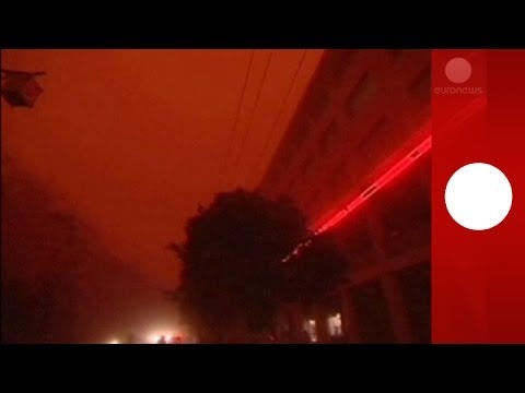 Day or night? Massive sandstorm plunges China into red mist