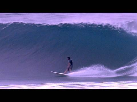 SURFING BIG BARRELS KIRRA