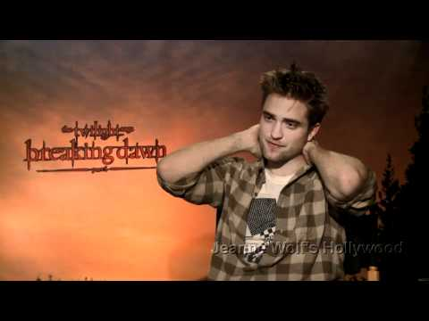 Robert Pattinson Bites And Kisses Kristen Stewart From Breaking Dawn Straight To The Box Office