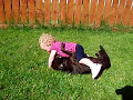 baby playing with Staffordshire Bull Terrier