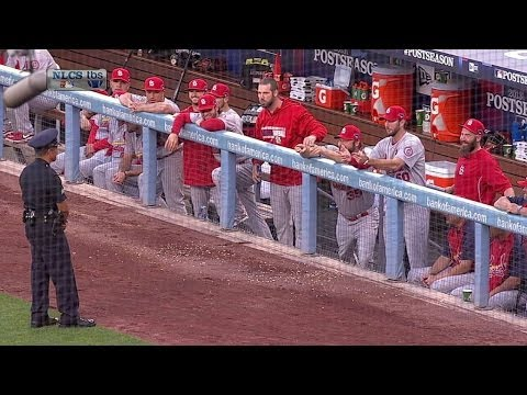 Cardinals' dugout try to make cop laugh