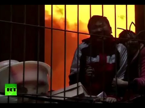 Dramatic video: Woman, boy trapped between fire & window grills in China