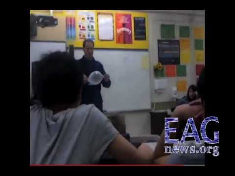 Teacher blows condom up like a balloon in health class