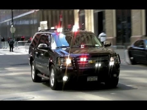 Secret Service Suburbans and NYPD Unmarked Police Vehicles