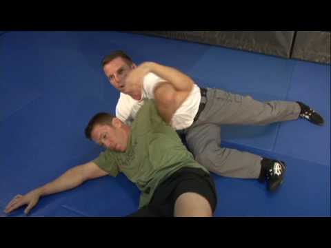 "POLICE DEFENSIVE TACTICS: ARM DRAG TO REVERSE SCISSOR SWEEP FROM ""GROUND SURVIVAL""DVD"