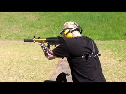Arm and leg amputee shooting full auto mp5 suppressed