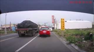 *Caught on DVR* Lady Driver Almost Flips Car While Trying to Overtake Trailer!