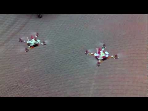 Real Swarm of Flying Nano Quadrotors Doing Flight Tricks HD