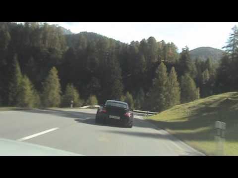 Audi RS5 following a Porsche 911 Turbo and a Ferrari F430
