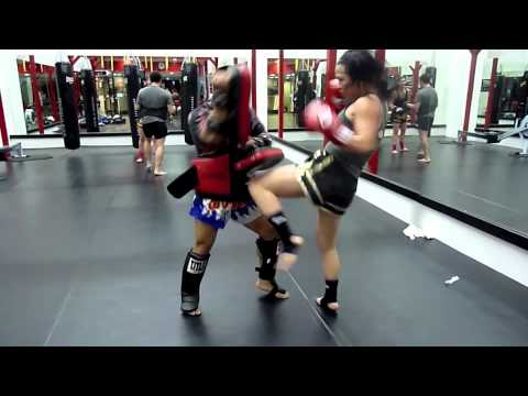 Female Muay Thai pad drills with Kru Jasper