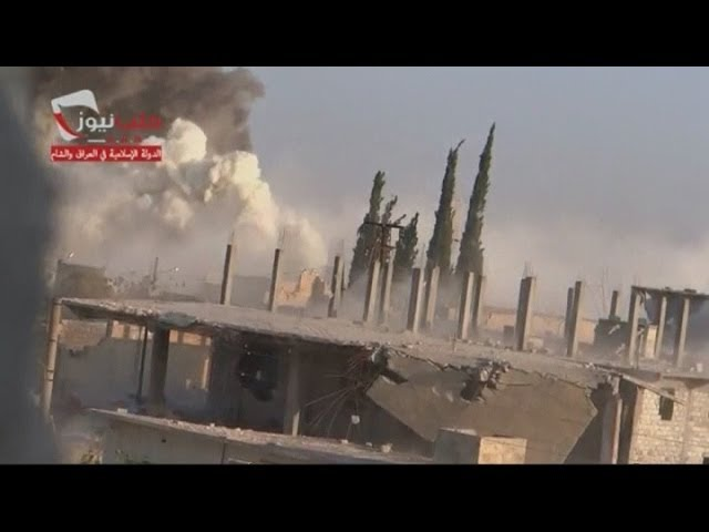 Amateur video shows explosion in Aleppo suburb and car bomb being prepared