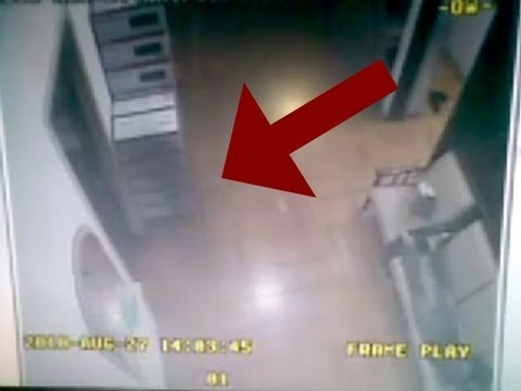 GHOST VIDEOS 2012: Real ghost caught on video in haunted house