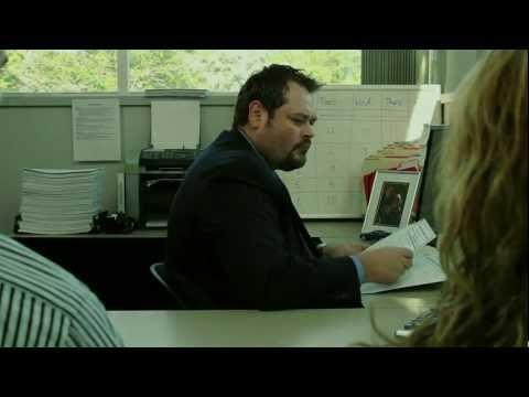 Funny car commercial. Scary finance manager negotiating used car finance with bad credit people.