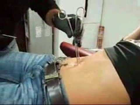 belly piercing - redwolf tattoo