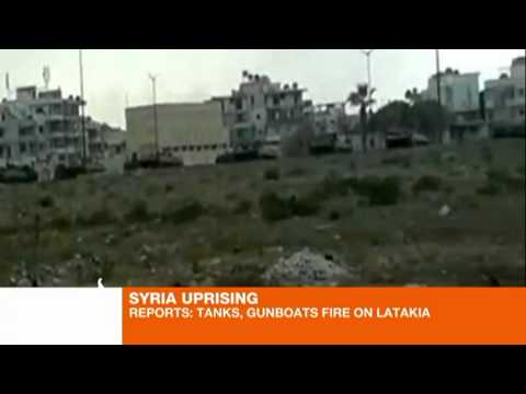 Tanks and gunboats 'fire on Latakia'