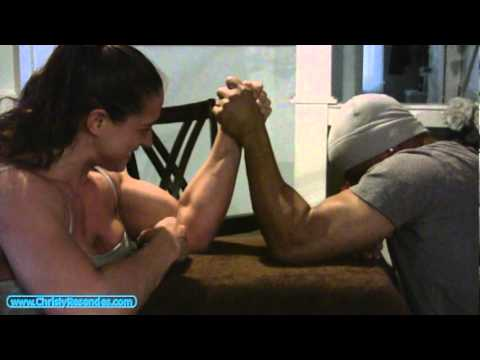 Female Bodybuilder Arm Wrestling Male Boxer