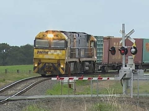 Long Freight Train at Level Crossing in Victoria - Railroads and Trains in Australia