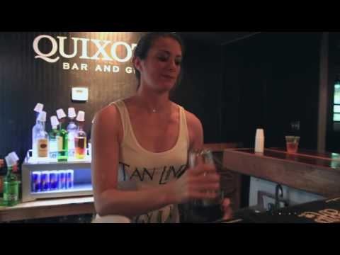 Amanda, a bartender at Quixote's, makes one of the bar's signature drinks.
