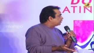 Brahmanandam joking on Trivikram Srinivas - Julayi Double Platinum Disc Function view on youtube.com tube online.