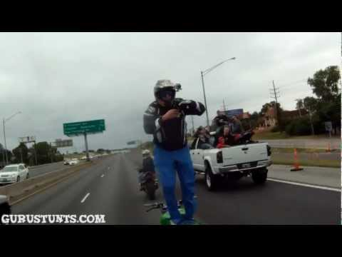 Insane Guy Stands Backwards on his Motorcycle on The Highway