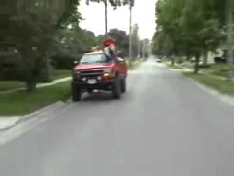 Idiot redneck driver ghost rides his truck and crashes!