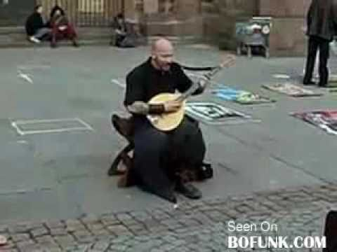bald tattooed guy sings like an angel