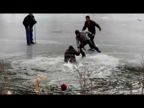 Would-be rescuers plunge into icy lake